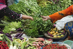 Sold! (Andrew Tan 2011) Tags: batik kotabharu kelantan malaysia buyandsell vegetables market sitikhadijahmarket sitting muslim women leafy cucumber brinjal mango chillies chilly bittergourd transaction passing give take sold deal baskets