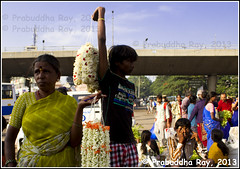 Flower Market, Bangalore (Prabuddha Ray) Tags: city morning bridge urban woman india flower bangalore citylife sell seller flowermarket overbridge canon7d prabuddharay