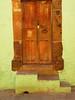 colonial door on yellow (msdonnalee) Tags: door mexico puerta doorway mexique tür entry mexiko 문 woodendoor vintagedoor colonialdoor mexicandoor photosfromsanmigueldeallende fotosdesanmigueldeallende spanishcolornialarchitecture