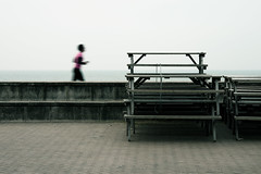 Jogger and Tables (JGMango) Tags: brighton exercise running tables static seafront jogging fitness past jogger chained