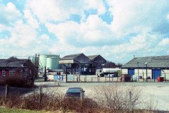 Fleet LaneOil Depot (Saturated Imagery) Tags: color industry film toxic 35mm iso100 grain leeds oil depot dlsr c41 artfilm vivitar28mmf25 woodlesford epsonv500 prakticatl5b agphotographic photoshopelements9 adoxcolorimplosion