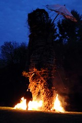 Casually walking through the burning legs! (Fenifur) Tags: man fire mayday wicker beltane beltain beltaine wickerman butser