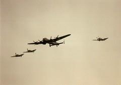 Two Bf109s in formation with BBMF Lancaster, Spitfire and Hurricane Fighter Meet North Weald Essex 15-05-95 (Richard.Crockett 64) Tags: fighter airshow lancaster ww2 spitfire 1995 bomber essex raf bf109 avro messerschmitt vickers worldwartwo luftwaffe me109 supermarine royalairforce battleofbritainmemorialflight bbmf northweald pa474 mkxix black6 ps915 fightermeet hansdittes
