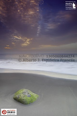 Alone on a lonely beach (Alesfra) Tags: ocean pink blue sunset sea sky sun seascape verde green sol beach water grancanaria rock azul stone marina canon landscape photography mar sand agua exposure alone dusk tide north rosa wave playa paisaje canarias beaty arena shore cielo solo edge tenerife lonely puestadesol soledad teide ocaso sola canonef1740mmf4lusm solitario roca ola belleza anochecer norte orilla islascanarias piedra marea fotografa exposicin ocano agaete solitaria aislado guayedra canoneos5dmarkii safecreative alesfra albertojespieirafrancs alesfraphotography alesfrafotografia wwwalesfracom leefilternd12grad fotoregistrada