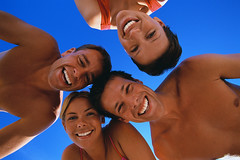 CB047910 (anchor1203) Tags: travel friends people men smiling portraits fun outdoors photography togetherness women eyecontact friendship barechested colorphotography happiness few males whites females humanrelationships maldives adults playful vacations enjoyment facialexpressions headandshouldersportraits partiallynude viewfrombelow