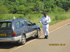 KYANKWANZI-POLICE CHIEF, giving  motorists stickers from (WHO) Geneva (Kyankwanzi District & CAGIEA- Long Short Walk) Tags: traffic who district chief stickers giving to motorists kyankwanzi