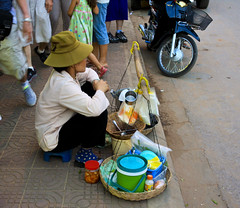 Selling from the sidewalk (Imagine Love Photography) Tags: poverty street food lady cambodia desperate sidewalk meal siemreap heavy selling income carry wage wages mealticket patiently patientlywaiting