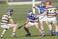 Mt.sion's Owen Whelan gains possession against Abbeyside's Gary Hurney and Tom Hanrahan during Rd2