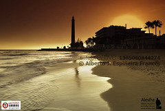 Maspalomas orange sunset (Alesfra) Tags: ocean light red sea sky espaa naturaleza sun sunlight lighthouse mountain seascape color reflection texture textura luz sol beach nature colors grancanaria marina canon landscape faro photography dawn mar photo spain rojo sand exposure foto natural alba playa paisaje canarias colores palm arena amanecer filter cielo aurora reflejo canary montaa palmera madrugada islascanarias fotografa maspalomas exposicin ocano meloneras sunsire canonlens wondersofnature sanbartolomedetirajana canonef1635mmf28liiusm sinnubes canoneos5dmarkii alesfra albertojespieirafrancs fotograncanariacom alesfraphotography alesfrafotografia wwwalesfracom leesunset3filter