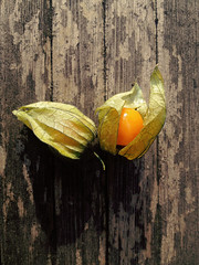 Physalis (Nada*) Tags: food iphone iphonegraphy instagram 4s iphone4s physalis fruit shell yellow colour color fresh nutrition eat vitamins wood rustic