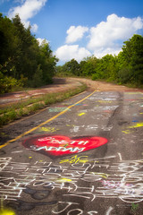 Burning Highway - Heart (Rock Steady Images) Tags: blue red vacation sky usa clouds canon eos graffiti highway paint heart pennsylvania pavement 7d centralia handheld 200views spraypaint 500views 50views cartrip topaz 25views niksoftware bypaulchambers canonef2470mmf28iiusm lightroom4 photoshopcs6 rocksteadyimages