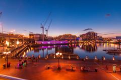 New Beginings (Sarceq) Tags: city longexposure blue sky water lights evening construction harbour sydney australia wideangle cranes bluehour darlinghabour