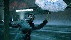 Singing in the Sleet (Daveography.ca) Tags: winter woman snow canada cold wet rain weather umbrella edmonton singing coat alberta wife jenn cinematic muttartconservatory muttart sleet singingintherain flickrfriday