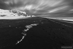 Black Beach (suzbah) Tags: ocean longexposure winter light sea sky blackandwhite mountain snow seascape motion black cold art ice beach nature monochrome weather mystery clouds contrast dark landscape outdoors lava coast iceland sand rocks desert south dramatic wave nobody eerie pebbles vik glacier arctic shore silence ash remote serene wilderness scandinavia picturesque volcanic depth deserted tranquil basalt myrdal blurredmotion reynisdranger reynisfjall