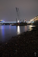 View from the banks of the Thames () Tags: city reflection london industry beach water skyline architecture night rocks engineering millenniumbridge cranes lowtide riverbank riverthames cityoflondon blackfriarsrailwaybridge sjl3991