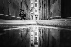 Two wheels. (Txipi Art'z) Tags: street city bw white black water shoot fuji candid streetphotography social human instant streetphoto monochrom xsries x100t