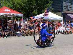 "Keith Dufrane and his ""Monowheel"" (oxfordblues84) Tags: street columbus ohio people man guy outdoors flag parade columbusohio spectators starsandstripes shortnorth unclesam usaflag victorianvillage doodah doodahparade holidayparade monowheel fourthofjulyparade fourofjuly"