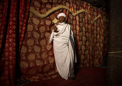 Ethiopian orthodox priest holding a cross inside a rock church, Amhara region, Lalibela, Ethiopia (Eric Lafforgue) Tags: africa travel man color men horizontal outdoors worship cross adult african curtain faith religion unescoworldheritagesite celebration holy indoors sacred priest christianity shawl spirituality ethiopia orthodox religiouscelebration oneperson traditionalculture lalibela hornofafrica ethiopian eastafrica thiopien etiopia abyssinia ethiopie traditionalclothing etiopa onlymen fulllenght onemanonly onematuremanonly  etiopija 1people ethiopi  africanculture etiopien etipia  etiyopya  amhararegion         semienwollozone ethio163597