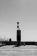 Le signal (Guy Heaume) Tags: sea mer ocan ocean atlantique atlantic ciel sky soleil sun rochelle breakwater digue architecture noiretblanc blackwhite people solitude