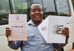 Tillya and his foster elephant certificate (Grete Howard) Tags: safariinafrica safari whichsafaricompany bestsafaricompany calabashadventures travel holiday africa kenya elephants davidsheldrickwildlifetrust elephantorphanage wildelife animals nairobi