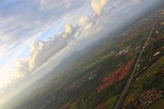 On Top of the World (Divya B) Tags: nature outskirts bangalore top airplane aeroplane flight plane plain clouds sky blue air land world green farms farm roads highway village