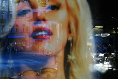 Poster reflection (tomavim) Tags: city red urban face reflections poster lips blond