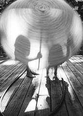 34| 100 (trois petits oiseaux) Tags: motion umbrella kids spin shadow light