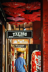 Shopping in Chinatown (elenaleong) Tags: signs shops redumbrella chineseculture chineseman  redcolor chinatownsingapore backpackerinn