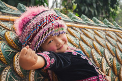Flower Girl (tylerkingphotography) Tags: city travel portrait people flower girl smile thailand photography clothing nikon southeastasia photographer outdoor traditional explore backpacking thai chiangmai 1855mm traveling cloth ethnic amateur garment d3100