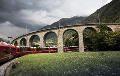 Brusio Viaduct (Anton Andreev) Tags: bridge red mountain alps nature stone train switzerland carriage scenic engineering railway viaduct express bernina brusio