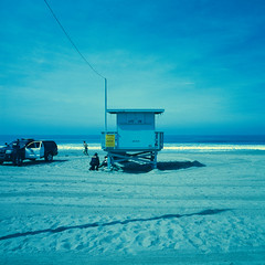 ave 26. venice beach, ca. 2016. (eyetwist) Tags: ocean california blue venice seascape color green tower 120 6x6 mamiya film beach water analog mediumformat square 50mm la losangeles los xpro crossprocessed surf waves cross pacific angeles kodak crossprocess horizon police lifeguard ishootfilm pacificocean socal alcohol venicebeach 400uc analogue mamiya6 process processed e6 ultra officer patrol baywatch westla citation emulsion lapd colt45 kodak400uc c41 ultracolor daydrinking angeleno uc400 oceanfrontwalk c41e6 lenstagger eyetwist 6mf mamiya6mf 26thavenue ishootkodak ave26 epsonv750pro betterlivingthruchemistry filmexif eyetwistkevinballuff mamiya50mmf4l crossprocessedc41toe6 iconla