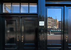 An Amsterdam landmark - Anne Frank House (Maria_Globetrotter) Tags: travel anna holland tourism netherlands dutch museum architecture canon reflections spring arquitectura war europe day doors exterior postcard entrance nederland landmark visit clear stunning planet prinsengracht lonely typical huis iconic  paysbas pases architectuur jordaan  arkitektur holand vr lightroom bajos nederlnderna twitter 650d 1585 larchitecture   263265 mariaglobetrotter