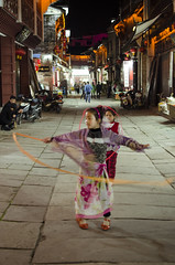 Girls playing (Roon & Beks) Tags: china street old town ancient twirl ribbon tunxi hunagshan