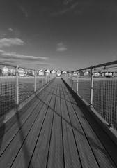 Pier at Mudeford by Hegistbury Head (Mike Nethercott) Tags: light christchurch bw white black beach water clouds coast pier wooden shadows huts dorset beachhut bournemouth jurassic southbourne mudeford jurassiccoast hengistburyhead