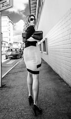 Take a walk on the wild side (lothar1908) Tags: street bw italy macro muro girl smile look canon strada italia nuvole pov walk sguardo mari cielo sorriso 20mm blondie toscana borsa gonna biancoenero scarpe gambe occhiali prospettiva esterno passi contrasto marciapiede mattonelle tacchi selciato empoli puntodivista 5dmarkiii