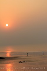 SERENE SUNRISE (Munisch) Tags: morning travel light sea sun india color beach water sunrise canon geotagged photography eos rebel dawn photo sand focus asia seashore digha stillphotography 550d t2i 55250mm