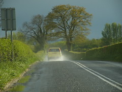 spray (rospix) Tags: road uk trees light green nature car rain weather wales countryside spring driving may spray countryroad 2013 rospix