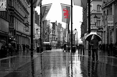 City Stroll (Gareth Priest) Tags: life street city uk portrait people urban bw inspiration reflection art cars public rain weather wales umbrella walking spring nikon experimental traffic candid flag taxi capital perspective creative cardiff innercity selectivecolour streetportait d5100