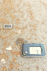 Forgotten Phone (Margaret Haggard Photography) Tags: broken photography phone cell busted flickrandroidapp:filter=none