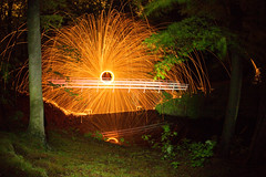 Steel wool light painting (michielmos) Tags: park longexposure bridge trees orange lightpainting holland tree nature night forest dark bomen nacht flames flash den natuur denhaag boom spinning brug haag sparks bos thehague donker vuur steelwool clingendael langesluitertijd vonken staalwol llightpainting