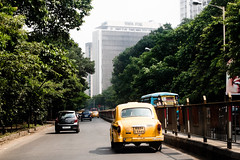 _9266151 (frederik_rowing) Tags: world road street trip travel portrait people india building tower heritage classic colors car yellow architecture landscape four corporate big driving colours traffic steel cab taxi tata great colonial goa documentary vivid headquarters olympus player unesco company riding busy monsoon lane micro rushhour hq ambassador calcutta hampi omd thirds ep1 ep2 ep3 kolkatta mft hindustan 1442 ep5 incredibleindia mirrorless