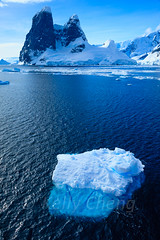 Antarctica-111124-721 (Kelly Cheng) Tags: travel blue sea white mountain color colour tourism nature water sunshine vertical landscape daylight colorful day outdoor vivid sunny antarctica bluesky nobody nopeople iceberg colourful copyspace seacape traveldestinations antarcticpeninsula lemairechannel