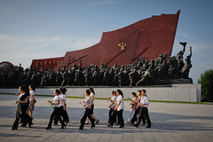 Paying respect to the Kims (Lil [Kristen Elsby]) Tags: travel history monument topv2222 asia statues korea editorial dailylife northkorea pyongyang eastasia dprk travelphotography payingrespect mansudae democraticpeoplesrepublicofkorea chosŏnminjujuŭiinminkonghwaguk mansudaegrandmonument grandmonument dprofkorea canon5dmarkii