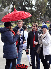 Carlton Blues (with Essendon Bombers) (Smith-Bob) Tags: street people woman hat smiling scarf laughing umbrella fan women carlton candid joke melbourne richmond conversation fans scarves beanie chatting bobblehat aussierules rivals mcg afl yellowandblack australianrulesfootball essendon theblues richmondtigers theg beforethegame thetigers carltonblues richmondfootballclub thebombers carltonfootballclub match4 essendonbombers sharingajoke aflfans 2013aflfinals