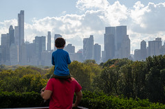 Father and Son looking from the MET (matthewzumwalt) Tags: nyc people newyork building tree green skyline kids cityscape centralpark metropolitan
