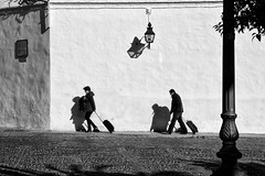 Suitcases (virtualwayfarer) Tags: street travel winter blackandwhite travelling silhouette wall walking blackwhite spain couple europe mediterranean january streetphotography andalucia luggage traveller southern espana cordoba andalusia suitcase bnw andelucia travelingtogether