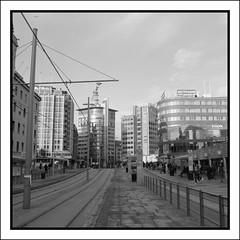 Jernbanetorget (Eirik0304) Tags: urban blackandwhite bw 120 film oslo norway mediumformat square norge kodak hc110 pentacon foma pentaconsix fomapan classicblackwhite classicblackandwhite mir38b bwfp 65f35 edrussellroberts analoggeeksofscandinavia