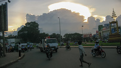 Phnom Penh at dusk (Kelly Rene) Tags: city sunset urban sun cambodia southeastasia traffic dusk phnompenh kh stormysky nightfall indochina