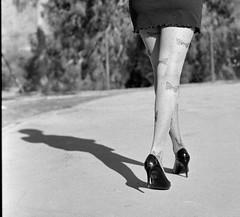 Walking (35mm film) (Cristo Bolaos) Tags: shadow blackandwhite woman blancoynegro film stockings analog butterfly nikon legs ishootfilm f90 heels tacones rodinal rodinal150 fp4 stilettos piernas filmisnotdead nikonf90