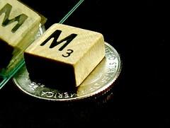 macro monday mirror (muffett68 ) Tags: tile mirror m dime hmm travelscrabble macromonday smallerthanacoin